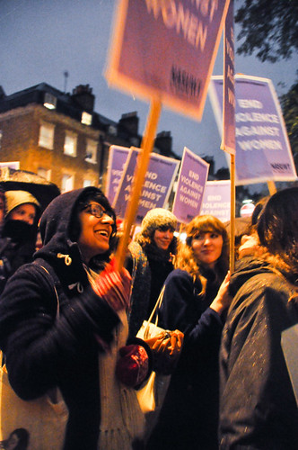 women smiling and holding placards