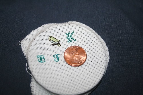 cross stitch pieces I made for gift lockets