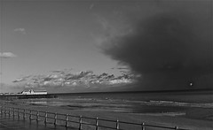 Seafront-storm cloud (Dave Arnold) Tags: uk blue light sea england sky cloud seascape storm black color colour reflection bird art beach water silhouette clouds composition reflections landscape sussex coast pier photo seaside movement sand waves moody colours shadows seascapes view artistic seagull gull south tide horizon shoreline creative wave atmosphere pebbles spooky coastal shore zen rainstorm coastline haunting ripples rays hastings southeast capture southcoast eastsussex atmospheric shimmer hastingspier