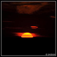 Like Godly GoldenEye,  Red Yellow Molten Sun,  Melt From Red Black Sky,  Into Black Sea It Run  - IMRAN  2300+ Views! (ImranAnwar) Tags: ocean sunset red sky sun newyork nature water silhouette yellow clouds square outdoors landscapes suffolk nikon marine seasons framed peaceful tranquility longisland imran 2010 d300 patchogue greatsouthbay supershot imrananwar eastpatchogue mywinners abigfave ultimateshot rubyphotographer