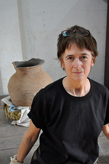 Joyce White with a pot from Tham An, a cavesite in Laos.