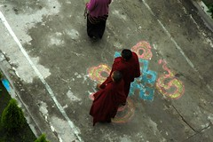 Monks walking over the auspicious infinity knot, Tharlam Monastery of Tibetan Buddhism, Boudha, Kathmandu, Nepal (Wonderlane) Tags: pink blue nepal green yellow lady walking religious grey path decorative infinity buddhist religion gray over buddhism knot fromabove tibetan kathmandu tradition spiritual enlightenment result mala initiation boudha empowerment auspicious tibetanbuddhist 5617 lamdre auspicioussymbol tharlammonasteryoftibetanbuddhism infinityknot groundedinfinity auspiciousinfinityknot