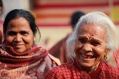 double simle (Samir D) Tags: people india canon eos 50mm asia dof double 18 kolkata bangla 2010 westbengal 40d canon40d samird
