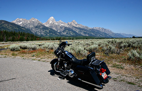 Our rented Harley Street Glide in front of the Grand Tetons.
