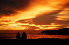 Romantic Sunset (Redbeard.01) Tags: ocean california santa sunset red santacruz reflection beach water birds yellow clouds photography lights coast sand nikon couple cruz romantic d200 sooc