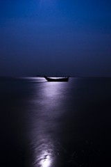 Melting in the sea... (Shad0w_0f_Dark) Tags: longexposure sky moon reflection water boat nikon sigma d200 1020 bangladesh nijhumdip