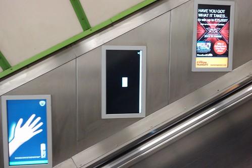 Broken Windows Advertising Screens on the Tube