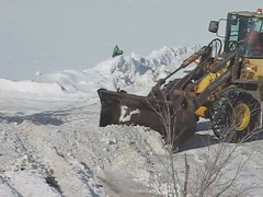 Clearing the Snowy Streets of Iowa (gene5335) Tags: winter snow storm ice weather midwest scenery parking suburbia iowa cleaning equipment plow removal 2009 backhoe frontendloader