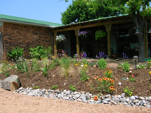 Raised Flower Bed bordered with River Rock // Decomposed Gravel Path