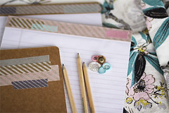 four kinds of happy (sweetjessie) Tags: pencils vintage paper buttons notepad barkcloth happytape