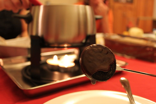 Chocolate oreo in chocolate fondue