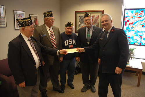 Members of the American Legion presents Major Richard Amick with a check for $2,000 to help with the Haiti relief effort.
