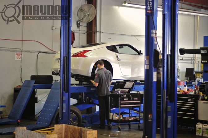Jason Langley working on Project Mothras rear brakes