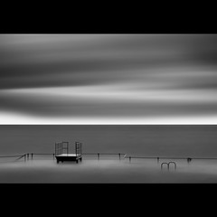 . . . s l o w s i l v e r . . . (s k o o v) Tags: longexposure morning sea bw motion blur canon silver 50mm 14 100v10f minimal guernsey 2010 ndfilters lavallette bathingpools nd110 skoov