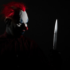 Come out and play (Spectral Convergence) Tags: scary clown knife freaky strobist