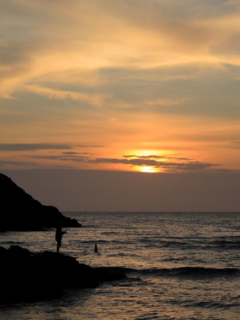 pecheur au coucher du soleil