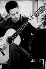 Stranger #65 - Erol (Universal Stopping Point) Tags: mall downtown guitar indianapolis indiana stranger atrium guitarist erol 100strangers bwpresetexposure