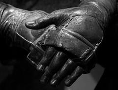Wrestler (Antti Tassberg) Tags: 2 blackandwhite bw sculpture monochrome statue hands ancient fighter roman bokeh fist harness armour gladiator monart