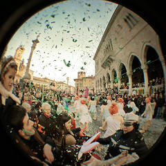 Carnival. From Inside. (pierofix) Tags: street city carnival sky italy tower clock rain stairs digital canon circle lens fun eos funny strada italia colours torre afternoon gente outdoor centre digitale crowd centro explosion wide wideangle super confetti fisheye celebration cielo duomo streamers festa carnevale colori orologio pioggia grandangolo 45mm carri circular divertente cerchio 2010 citt friuli palla esterno loggia coriandoli stellefilanti udine flinstones gradini pomeriggio esplosione loggiadellionello tonda folla reducer piazzadellalibert focale 025x 400d riduttore richarm bestfisheye2010