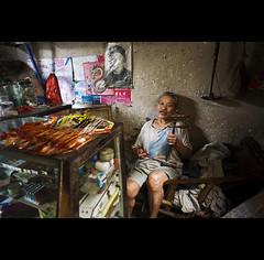 the singer owner - China (© Tatiana Cardeal) Tags: china musician woman playing shop digital ancient asia village singing yangshuo erhu singer 中国 2009 中國 guangxi fuli chineseviolin guangxizhuangautonomousregion