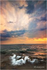 Spensieratezza, Lago di Garda - Thoughtlessness, Garda Lake - Italy (Enrico Grotto) Tags: sunset lake color reflections landscape lago nikon san garda soft tramonto nuvole wave cielo lee punta nikkor filters acqua colori riflessi luce paesaggio 1224 onda sirene baia gnd d40 wondersofnature cluod vigilio o9 manerbe grottoenrico
