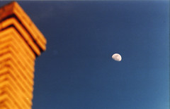 on the rise (caterpiya) Tags: blue sky orange moon building brick film contrast analog 35mm mississippi photo saturated focus skies minolta bricks photograph manual manualfocus meridian srt101 srt