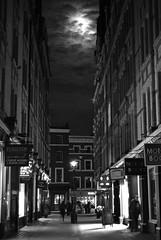 20091102 - London nights (becksldrt) Tags: sky moon london westminster night clouds streetlight streetlamp streetphotography nightsky westend latenightshopping bookshops 306365 project3661 bookshopstreet
