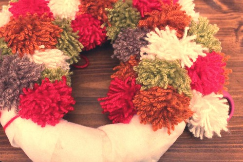 that yarn pom pom wreath is almost finished