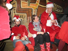 Noc Noc Santa Lounge (Lynn Friedman) Tags: sf sanfrancisco california santa christmas ca xmas costumes red usa holiday beer bar costume santas nightclub tinsel santacon santahat lowerhaight sfist redvelvet rainboots nocnoc 94117 haightst stripedstockings santasuits lynnfriedman santacostumes sfsanta09