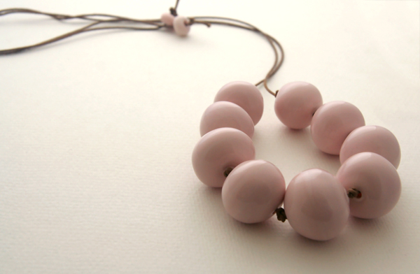 Pink hollow beads arranged in a necklace to wear.