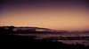 Omaha Beach at dawn (Momento Creative) Tags: ocean sea newzealand sky mist beach night sunrise dawn twilight nikon rocks d70 tide naturallight adobe lonely nikkor lightroom 1870 omahabeachholidaysunrisebach