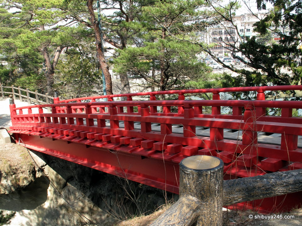 Red colored bridges are a beautiful feature of Japanese gardens.