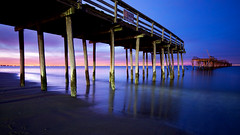 ocean of blue (Sky Noir) Tags: ocean travel blue sunset sea sky usa beach night photography virginia pier us fishing sand surf noir unitedstates cloudy unitedstatesofamerica va bluehour stormdamage oceanblue hamptonroads blueocean lynnhaven tidewater skynoir bybilldickinsonskynoircom