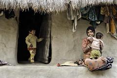 Family (Shamim Ahmed Photos) Tags: india face childhood rural children child innocent mother canon350d bengal babyface ecofriendly westbengal boychild indianface incredibleindia impressedbeauty gaurdaha