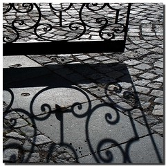 Embroideries of light (Nespyxel) Tags: light blackandwhite bw design gate shadows prague praha praga bn ombre cobblestones luce biancoenero cancello pave embroideries ricami challengeyouwinner pleasedontusethisimageonwebsites blogsorothermediawithoutmyexplicitpermissionallrightsreserved