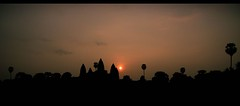 people say don't judge a book by it's cover. so... sunrise or sunset? (eask) Tags: orange holiday silhouette sunrise canon cambodia angkorwat tamron 450d abigfave platinumbestshot