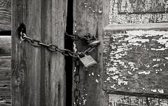 locked (Sam Scholes) Tags: door bw slr abandoned film analog rural 35mm dark nikon industrial factory shadows lock decay gritty sugar idaho chain whitney sweets weathered n80 peelingpaint locked chained ilforddelta franklincountysugarco