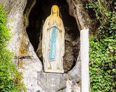 (dominicatorumstudiorum) Tags: grotto pilgrimage niche france cave praying devout green our rock statue kneeling venerated virgin spiritual roman persons people basilica religious massabielle lady spectators marian church blessed sacred french pilgrims catholic sanctuary tourists holy catholics tourism religion dame immaculate conception candles site prayer lourdes visiting notre shrine mary
