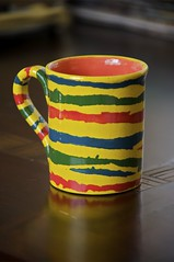 Jagged Java Jug (pea g.) Tags: morning shadow red stilllife orange brown reflection green cup yellow ceramic table shiny colorful paint pattern shine bright stripes painted glossy gradient mug pottery jagged coffeemug flecks multicolored striped