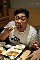 Furious (scion_cho) Tags: portrait people food japan dinner pose eating chinesefood candid eat chopsticks filipino hungry caughtintheact pinoy furious embarassing gulp 35mmf2af