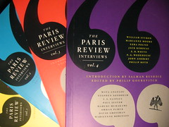 Paris Review Interviews covers in yellow, blue, red and purple