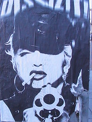 (unknownly) Tags: streetart sexy art hat cool eyes pretty gun good cigarette madonna awesome great lips smoking singer revolver mole hoops