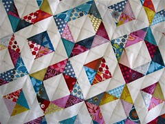 geometric squares. ({ philistine made }) Tags: quilt quilting jeweltones halfsquaretriangles winter2009 geometricsquaresquilt