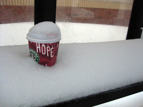 Abandoned Lipstick-Stained Starbucks Cup in Bus Stop Bench Snowdrift