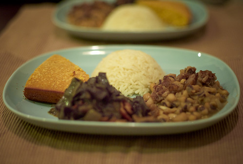 Black-Eyed Peas with Smoked Ham Hocks, Garlic Rice, Collard Greens with Bacon and Red Onion and cornbread.