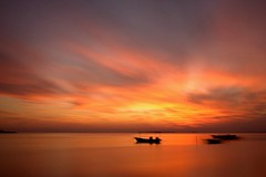 Burning Sky at Hamala Bahrain (Helminadia Ranford) Tags: sunset red sky orange seascape nature beautiful skyscape landscape photography boat yahoo bahrain google view arabic burning arab passion gcc helminadia hamala