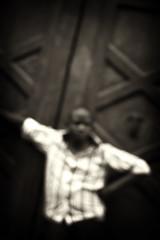 . (SigmundD) Tags: street door wood white black shirt fuzzy blues uomo camicia bianco nero legno portone pistoia sfocato