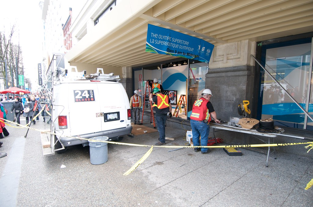 Workers Repair Broken Windows From Day 2 Protests