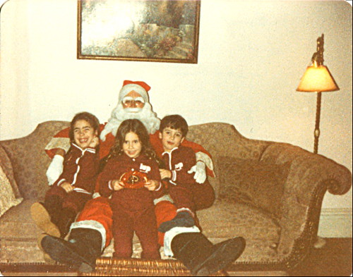 my sister, my brother and me in matching IUP outfits with santa mom