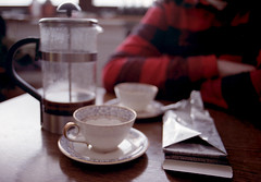 Coffee, chocolate and conversations (Sina Farhat) Tags: friends light film home coffee analog photoshop dark gteborg sweden bokeh chocolate background details gothenburg shapes negative scanned photowalk sverige former discussion psd canona1 vnner fika diskussion 81 031 hem cs4 ljus detaljer adobecameraraw mrk choklad 2400dpi bakgrund skrpedjup johanlund fotopromenad canon50mm14fd inscannad fujisuperiaxtra40036